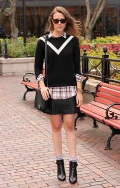 Sweater over plaid flannel, leather skirt, booties.