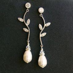 Potential Earrings for Becky: Rhinestone Leaf Bridal Wedding Earrings, Ivory Bridal White Pearl Earrings, Garden Wedding Jewelry, Rhinestone Vintage Bridal Jewelry, EDEN. $45.00, via Etsy.