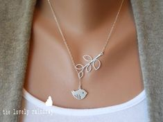 This necklace is made from a sterling silver chain and is decorated with a rhodium plated tree branch and bird pendant.    From thelovelyraindrop on Etsy.