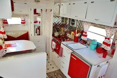 vintage travel trailer - red and white kitchen