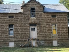 Built in 1888.  One of the first buildings in Seymour.  It's a complete wreck except for the stone walls.  Someone has started working on it recently.  May and Miller in Seymour, Texas.