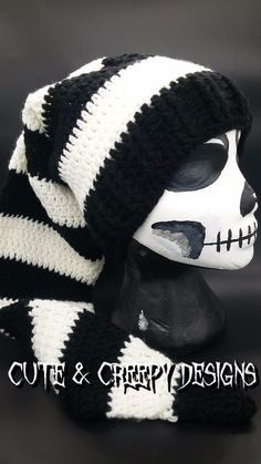 """This Black & White Elf Hat features acrylic white, and black yarn from Red Heart. If you're looking for an adorable spooky hat for a killer cute costume, this is it! https://www.etsy.com/listing/471925144/black-white-elf-hat  About 3' long Adult size- about 23"""" circumference (I've seen some children fit into my hats so shoot me a PM and talk to me about sizes). Machine washable on delicate settings in a lingerie bag, and lay out flat to dry.  For international shipments: Shipping charge may…"""