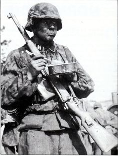 A young Grenadier of 12th-SS HJ in France enjoys a quick meal between battles. Many of the surviving photographs from the division in France were taken by SS-PK man Woscidlo including the famous photographs of the battle weary troops in Rots after their failed night attack.