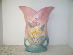 Offered for sale is this beautiful vintage Hull Art Pottery Vase done in embossed magnolia flowers on the front and back of vase. The vase