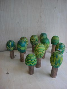 waldorf blocks - love these! Green painted decorative trees. For older children perhaps. Decorative. Not quite simple enough for kinder steiner