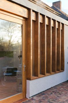 To one side of the space, a large picture window onto the garden is framed by deep timber mullions that provide privacy and reduce overlooking from the neighbours defining a more private and reflective area within the main space.