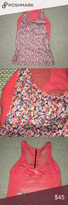 Rare Lululemon Top They don't make this style or print anymore but this was super flattering hugs right at the waist! I always got compliments at they gym! Worn literally 3 times before I got fat! Floral pattern with coral top with built in bra lululemon athletica Tops Tees - Short Sleeve