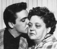 It's a nice image of Elvis kissing his mom, but Gladys looks so sad.  I believe this shot was taken as Elvis prepared to join the Army.