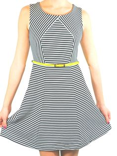 Shopmamie.com - Night and Day Dress, $66.00 (http://shopmamie.com/night-and-day-dress/) Black and white striped dress with neon belt.