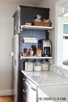 "Vertical Space for Floating Shelves: ""This way I can keep all the things I use most often - coffee maker, knives, salt and pepper, paper towels, baskets for bread and produce, and spare grocery items - right on hand without sacrificing counter space"""