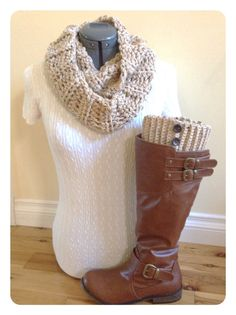Up for sale is a set of boot cuffs with buttons with a matching infinity scarf in an oatmeal color. The infinity scarf measures 48 inches