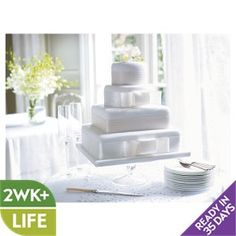 Fiona Cairns 4-tier Ribboned Wedding Cake (Sponge) £220 FOR 110 PEOPLE WAITROSE