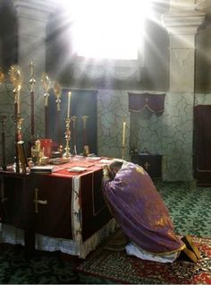 Christian Orthodox priest praying in the altar.