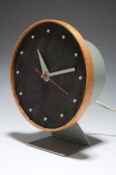 George Nelson; #4767 Wood, Enameled Metal and Painted Masonite Table Clock for Howard Miller, 1949.