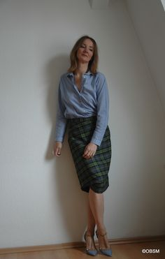 Business chic: Vivienne Westwood pencil skirt and blue men's shirt.