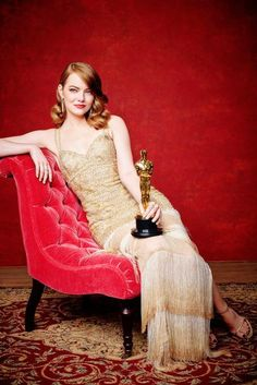 Emma Stone wearing Stuart Weitzman Nudist Sandals in Pale Gold, Nars Audacious Lipstick in Mona, Nars Blush in Orgasm and Nars Illuminator in Hot Sand