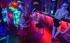 Models mingle at the bar prior to the Bodyspectra body painting event in Cape Town, South Africa Picture: EPA/NIC BOTHMA