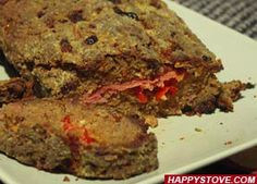 Italian Meat Loaf with Red Pepper Stuffing is a yummy recipe for a stunning main dish. Enjoy the mix of pancetta, red peppers, ground beef and cheese in this delicious meat loaf meal. Great also with leftovers.