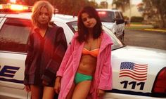 Busted in a bikini! Swimsuit-clad Selena Gomez posts Twitter picture of her and Ashley Benson getting arrested in scenes for Spring Breakers