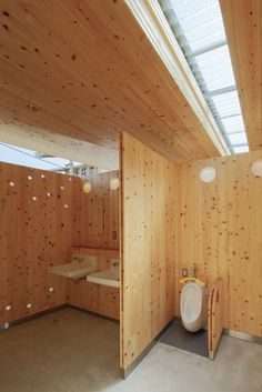 """Image 11 of 18 from gallery of """"KITERASU"""" Model CLT Building at Kuse Station / ofa. Photograph by Ken'ichi Suzuki Wc Public, Outdoor Toilet, Restroom Design, Wooden Bathroom, Design Competitions, Interior Architecture, Floor Plans, Loft, Gallery"""