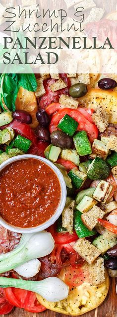 Shrimp and Zucchini Panzanella Salad Recipe | The Mediterranean Dish. An all-star Italian Panzenalla Salad with heirloom tomatoes, shrimp, roasted zucchini and more! A thick garlicy sun-dried tomato dressing served on the side! The perfect appetizer for a crowd! Click on the image to get the recipe. Or See more at TheMediterraneanD...