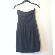 """Little Black Dress NWOT, never worn. Sweetheart bodice, strapless with diagonal waist line that forms a point. Skirt has flattering """"pleats"""" and comes out a bit, but still bodycon fit. Zipper on left hand side and 9 faux button detail on back of dress. Measures just under 24 inches. Size medium. Forever 21 Dresses Strapless"""