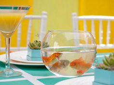DIY Projects and Ideas for Creating Retro-Style Wedding: Bring the table to life with a touch of kitsch. Goldfish bowl centerpieces are a great non-floral alternative. They are economical and easy to assemble and they are sure to keep the atmosphere light and festive.  From DIYnetwork.com
