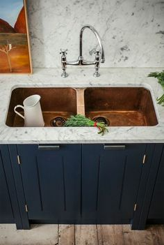 If you asked me yesterday if I'd pick a copper sink to go with Carrara marble countertops, I would have said, eh, probably not. Classic stainless steel meshes better with the gray tones in the marble, no?     But now that I've seen this photo, I take it back. I take it all back. Copper + Carrara marble + dark blue-black cabinets = perfection.
