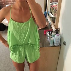 Sabo skirt neon green romper Like new adorable neon green romper from sabo skirt. Straps are adjustable allowing wearer to determine how low the romper falls on the chest. Perfect for summer. Wear to the beach or out at night! Sabo Skirt Shorts