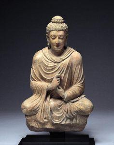 Seated Buddha with Dharmachakra Mudra (turning the wheel of Dharma). Hadda or Taxila, 4th-5th centuries.