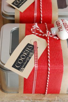Window tins are easy to dress up with kraft paper, baker's twine, ribbon and a tag. #holidayentertaining