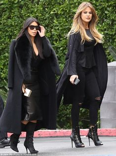 Twice as nice: Kim and Khloe Kardashian walked side by side as they both headed to their Los Angeles office on Friday