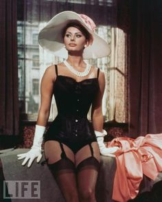 Like a Million Bucks  In a scene from 1960's The Millionairess, Loren is sophisticated (note the pearls and gloves) and sexy (hello, garters!).  Love that hat !