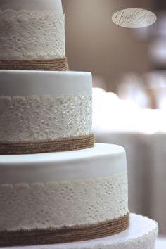 White vintage lace, twine wedding cake