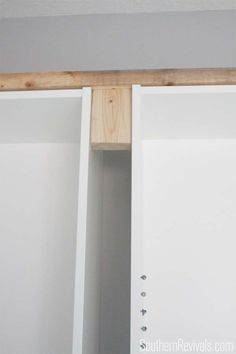 Place 2x4s between bookcases at top and bottom for added stability