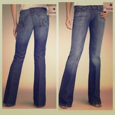 Citizens of Humanity jeans Dark wash jeans with mild distressing at the cuffs and pockets. Single button enclosure, low rise flare. Inseam 28 inches, rise 8 inches. Citizens of Humanity Jeans Flare & Wide Leg