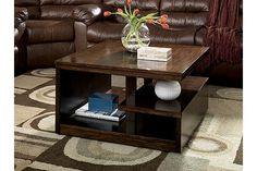 """The Callum Coffee Table from Ashley Furniture HomeStore (AFHS.com). The """"Callum"""" accent table collection features a unique design and a rich finish to create a contemporary styled collection that is sure add an air of artistic sophistication into any living room environment."""