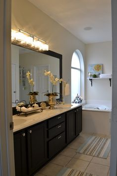 master bath - paint cabinet black.  white walls? navajo white by bm