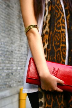 high gold armband and YSL clutch in red; perfect for contrasting prints