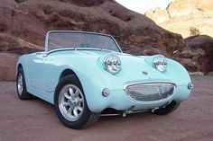 Austin Healey Sprite 1957 maybe? Saw one of these babies today in the same color...was so sweet.