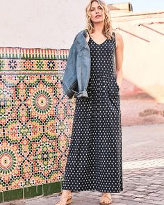 f28175824827a A magnificent maxi in soft, organic-cotton and TENCEL® jersey flatters with  an open neckline, ruching at the waist, and casually slanted pockets.