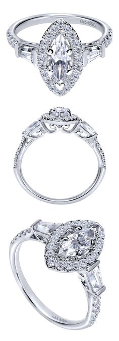 A stunning 14k White Gold Victorian Halo Engagement Ring with a Marquise center stone.