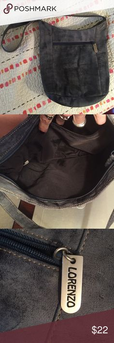 """Grey / blue purse, cross body or shoulder bag Greyish blueish purse in great condition except a few scratches on the left side part of the purse only noticeable if you're really looking at it. Faded/ distressed look to it that was made to be that way. Soft leather like feel. Dimensions H 10"""", W laying flat 10& 3/4"""", Depth on bottom 4"""" Lorenzo Bags Crossbody Bags"""