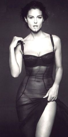 (Monica Bellucci) Smoking may be bad, but her being so smoking hot is oh so good.