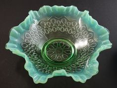 Green Opalescent ruffled and crimped bowl in the Many Loops pattern by Jefferson Glass Company.  circa 1907.This stunning antique bowl measures 8 inches across and is 2 1/5 inches at the highest point