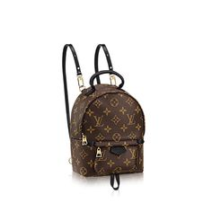 Discover Louis Vuitton Palm Springs Backpack Mini: Nicolas Ghesquière gave a surprising twist to the backpack, turning a utilitarian staple into this trendy and oh-so-covetable city bag. The sweet Mini version in soft Monogram canvas sports a multi-positional strap for cross-body wear.