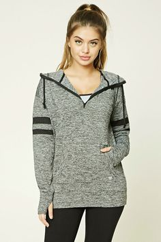 c8b0d7cc924 A marled knit athletic hoodie featuring a partial zip-up front