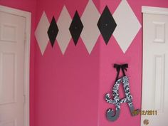 Argyle nursery wall pattern with design painted using pink black and white paint color combination