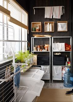 Balcony for laundry with a white drying rack and a white clothes rail