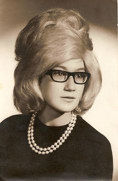 Southern Baptist Helmet Hair.All the rage from 1950s to the early 1980s.They felt Big Hair Bands were mocking them.Truly homage.